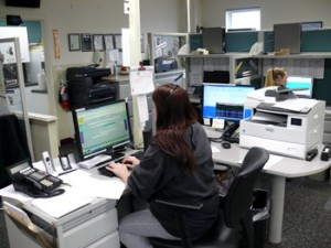An Answering Service Agent working at Anserve Office